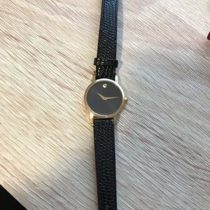 Movado black and gold museum watch